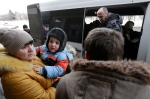 People board a bus to leave the town of Debaltseve, Ukraine on Saturday, Jan. 31, 2015. Fighting between government and Russian-backed separatist forces in eastern Ukraine has intensified in recent days as rebels seek to encircle the town, which hosts a strategically important railway hub. (AP / Petr David Josek)