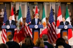 U.S. Secretary of State John Kerry, center, speaks at a news conference with Canadian Foreign Minister John Baird, left, and Mexican Foreign Secretary Jose Antonio Meade at Faneuil Hall in Boston, Saturday, Jan. 31, 2015. (AP / Winslow Townson)