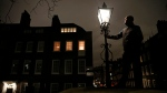 British Gas Operations Manager Iain Bell inspects a gas burning street light in central London. (AFP PHOTO / ADRIAN DENNIS)