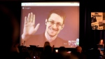 Former National Security Agency, NSA contractor and whistleblower Edward Snowden follows the 2014 Carl von Ossietzky Medal award ceremony by the International League for Human Rights via live video transmission in Berlin, Germany, Sunday Dec. 14,2014. (AP / dpa,Wolfgang Kumm)