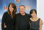 Susan Schneider, Robin Williams, and Zelda Williams arrive at the premiere of 'Happy Feet Two' at Grauman's Chinese Theater, in Los Angeles in 2011. (AP / Katy Winn)