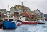 Fishing boats sit loaded with lobster traps in Peggy's Cove, N.S. on Friday, Nov. 29, 2013. (Andrew Vaughan / THE CANADIAN PRESS)
