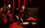 Madonna stumbles while performing on stage during the Brit Awards 2015 at the 02 Arena in London on Wednesday, Feb. 25, 2015. (AP / PA / Yui Mok)