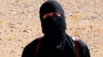 This undated image shows a frame from a video released Friday, Oct. 3, 2014 by Islamic State militants. Mohammed Emwazi has been identified by news organizations as the masked militant more commonly known as 'Jihadi John.'