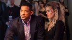 In this image released by Warner Bros. Pictures, Will Smith and Margot Robbie, right, appear in a scene from 'Focus.'