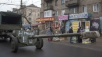 Ukrainian weapons are towed by vehicles as heavy weapons are withdrawn in Mariupol, eastern Ukraine, Thursday, Feb. 26, 2015. (AP /Evgeniy Maloletka)