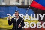 Boris Nemtsov, a former Russian deputy prime minister and opposition leader addresses demonstrators during a massive rally to oppose president Vladimir Putin's policies in Ukraine, in Moscow, Saturday, March 15, 2014. (AP / Alexander Zemlianichenko)