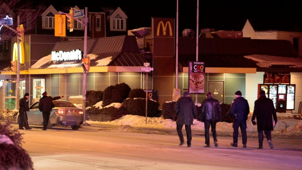 Police attend the scene of a shooting at a McDonald's restaurant near Danforth and Coxwell avenues Saturday February 28, 2009. (John Hanley /CP24)