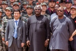 In this photo taken on Sept. 25, 2014, Chinese Ambassador Zhao Yanbo, centre left, stands next to Sierra Leone's President Ernest Bai Koroma, centre, and Sierra Leone's Vice President Samuel Sam-Sumana, centre right, during the opening ceremony of the China Friendship Hospital catering for Ebola virus patience in Freetown, Sierra Leone. (Michael Duff/AP Photo)