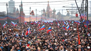 People carry Russian national flags during a march in memory of opposition leader Boris Nemtsov. (AP / Dmitry Lovetsky)