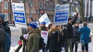 Strikers march at the University of Toronto on Monday, March 2, 2015.