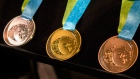 Toronto 2015 Pan Am Games silver, gold and bronze medals are displayed as the organizing committee unveils the medals that will be awarded at the games during an announcement in Toronto on Tuesday, March 3, 2015. (Chris Young / THE CANADIAN PRESS)_