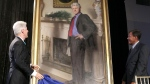 Bill Clinton, left, looking at his portrait at the Smithsonian Castle Building in Washington. (AP / Haraz N. Ghanbari)