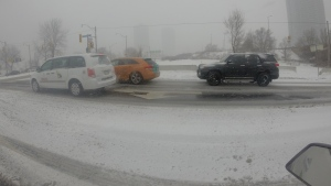 Cars drive in the snow in Toronto, March 3, 2015. (George Stamou / CTV Toronto)