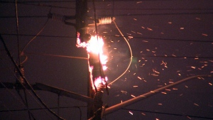 Sparks fly from a hydro pole transformer on Victoria Park as crews work to restore power to the area, Wednesday, March 4, 2015.
