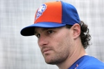 In this Feb. 26, 2015, file photo, New York Mets' Daniel Murphy pauses while working out in a batting cage during a spring training baseball practice in Port St. Lucie, Fla. (Jeff Roberson / AP Photo)