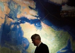 Prime Minister Stephen Harper is silhouetted against a map of Northern Canada during a reception commemorating the Franklin Expedition at the Royal Ontario Museum in Toronto on Wednesday, March 4, 2015. (THE CANADIAN PRESS / Darren Calabrese)