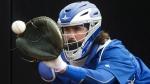 Toronto Blue Jays catcher Jack Murphy catches a bullpen session during baseball spring training in Dunedin, Fla., on Feb. 23, 2015. (Nathan Denette / THE CANADIAN PRESS)