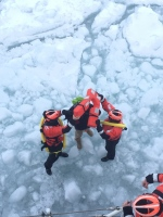 In a photo provided by the crew of Coast Guard Cutter Neah Bay, home-ported in Cleveland, Ohio, rescues a 25-year-old man attempting to walk across Lake St. Clair, March 5, 2015. (U.S. Coast Guard, Lt. Josh Zike/AP Photo)