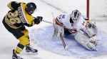 Calgary Flames goalie Karri Ramo makes a glove save on a shot by Boston Bruins right wing David Pastrnak during the shootout of an NHL hockey game in Boston on March 5, 2015. (AP / Charles Krupa)