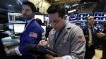 Trader Joseph Lawler works on the floor of the New York Stock Exchange on March 5, 2015. (AP / Richard Drew)