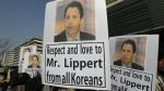 South Korean conservative activists hold portraits of U.S. Ambassador to South Korea Mark Lippert during a rally demanding his quick recovery near the U.S. embassy in Seoul, South Korea on March 6, 2015. (AP / Ahn Young-joon)