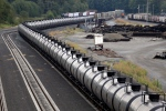 In this Sept. 2, 2014 photo, a northbound oil train sits idled on tracks, stopped by protesters blocking the track ahead, in Everett, Wash. (Elaine Thompson / AP Photo)