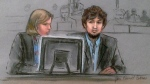 In this courtroom sketch, Dzhokhar Tsarnaev, right, and defense attorney Judy Clarke are depicted watching evidence displayed on a monitor during his federal death penalty trial in Boston on Monday, March 9, 2015. (AP / Jane Flavell Collins)