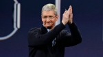 Apple CEO Tim Cook applauds at an event in San Francisco, on March 9, 2015. (AP Photo/Eric Risberg)