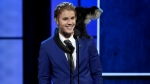 A monkey rests on Justin Bieber's shoulder as he speaks at the Comedy Central Roast of Justin Bieber at Sony Pictures Studios on Saturday, March 14, 2015, in Culver City, Calif. (AP/ Chris Pizzello/Invision/)