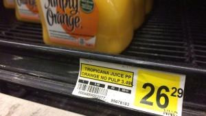 A price tag lists the price of a jug of orange juice at a grocery store in Iqaluit, Nunavut on Dec. 8, 2014. (Sean Kilpatrick / THE CANADIAN PRESS)