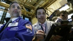 Specialist Anthony Rinaldi, left, and trader Joseph Lawler work on the floor of the New York Stock Exchange on March 24, 2015.  (AP / Richard Drew)