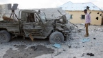 Wreckage of a car that carried the bomb and was detonated at the gate of one of Mogadishu's most popular hotels, on March, 27, 2015. (AP / Farah Abdi Warsameh)