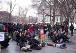 Demonstrators sit on the street at an anti-austerity protest, Thursday, March 26, 2015 in front of the legislature in Quebec City. (THE CANADIAN PRESS / Jacques Boissinot)