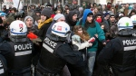 Police disperse demonstrators as students protest in Montreal against proposed austerity changes by the provincial government, Monday, March 23, 2015. (Ryan Remiorz / THE CANADIAN PRESS)