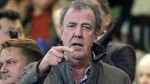 In this Wednesday, March 11, 2015 file photo, TV host Jeremy Clarkson gestures as he takes his place in the stands before the Champions League round of 16 second leg soccer match between Chelsea and Paris Saint Germain at Stamford Bridge Stadium in London. (AP / Matt Dunham, File)
