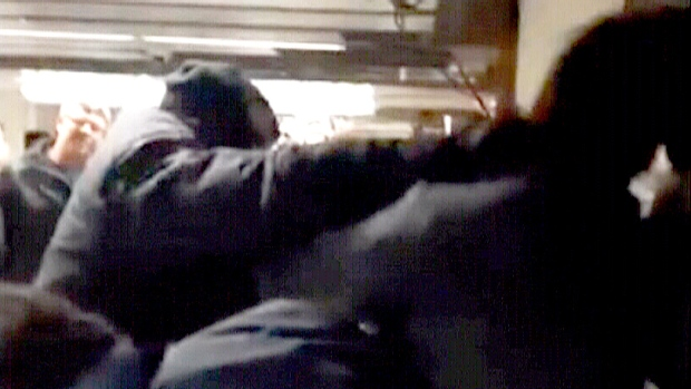 A video posted to Facebook on Tuesday night appears to show two TTC officers punching one man in the face multiple times and another man in the ribs.