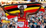 Moses Kipsiro of Uganda celebrates after winning the 10,000 metre final at Hampden Park Stadium during the Commonwealth Games 2014 in Glasgow, Scotland, Friday Aug. 1, 2014. (AP / Frank Augstein)