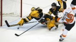 Philadelphia Flyers' Vincent Lecavalier gets a shot under the stick of Pittsburgh Penguins goalie Marc-Andre Fleury for a goal in the first period of an NHL hockey game in Pittsburgh on April 1, 2015. (AP / Gene J. Puskar)