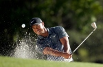 In this file photo, Tiger Woods hits out of a bunker on the 18th hole during the third round of the Masters golf tournament on April 11, 2015, in Augusta, Ga. (AP / Chris Carlson)