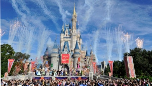This image released by Disney shows fireworks punctuating the sky at the grand opening celebration at the Cinderella Castle for the New Fantasyland attraction at the Walt Disney World Resort's Magic Kingdom theme park in Lake Buena Vista, Fla. on Dec. 6, 2012. (Gene Duncan / AP Photo)