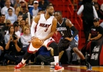 Miami Heat's Dwyane Wade (3) dribbles the ball against Orlando Magic's Victor Oladipo (5) during the second half of an NBA basketball game, Monday, April 13, 2015, in Miami, Fla. (AP / Joel Auerbach)