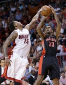Raptors guard Louis Williams (23) goes up for a three-point shot against Miami Heat guard Mario Chalmers (15) during the second half of an NBA basketball game, Saturday, April 11, 2015, in Miami. (Wilfredo Lee/AP Photo)