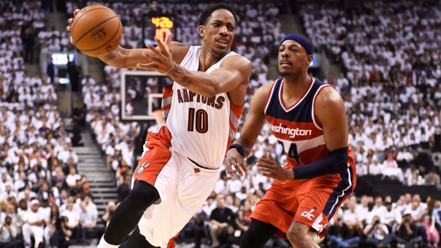 Toronto Raptors' DeMar DeRozan (10) is fouled by Washington Wizards' Paul Pierce (34) during NBA playoff action against the in Toronto on Saturday, April 18, 2015. (Frank Gunn / The Canadian Press)