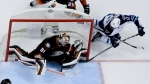 Anaheim Ducks goalie Frederik Andersen, left, blocks a shot by Winnipeg Jets right wing Drew Stafford during the third period of Game 2 of a first-round NHL hockey playoff series in Anaheim, Calif., Saturday, April 18, 2015. (AP Photo/Chris Carlson)