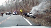 Woman rescued from overturned car by police