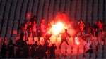 In this Feb. 1, 2012 file photo, Egyptian fans clash with riot police following an Al-Ahly club soccer match against Al-Masry club at the soccer stadium in Port Said, Egypt. (AP Photo)