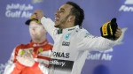 Mercedes driver Lewis Hamilton, right, jumps in celebration after winning the Bahrain Formula One Grand Prix, on April 19, 2015. (AP / Luca Bruno)