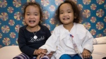 Phuoc and Binh Wagner pose in a photo at the Hospital for Sick Children in Toronto, Monday, April 20, 2015. (Sick Kids Hospital)