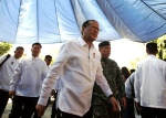 Philippine President Benigno Aquino III arrives to attend the Assumption of Command Ceremony of the Philippine National Police Special Action Force (SAF) at Camp Bagong Diwa, Taguig, south of Manila, Philippines, on March 4, 2015. (AP / Aaron Favila)